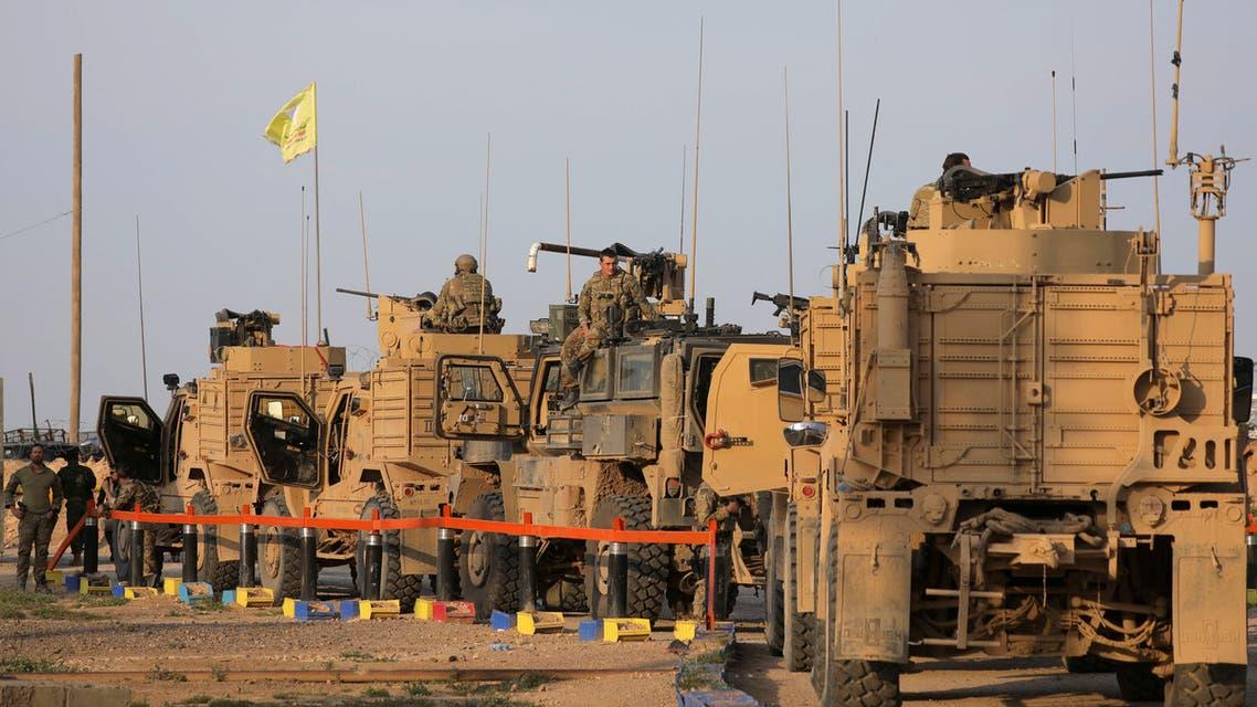 American soldiers stand near military trucks, at al-Omar oil field in Deir Al Zor, Syria March 23, 2019. REUTERS/Rodi Said
