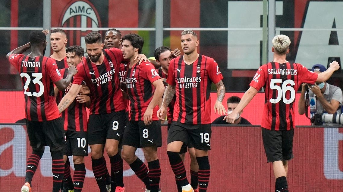 AC Milan's Olivier Giroud, celebrates with his teammates after scoring his side's fourth goal from the penalty spot during a Serie A soccer match between AC Milan and Cagliari, at the San Siro stadium in Milan, Italy, on Aug. 30, 2021. (AP)