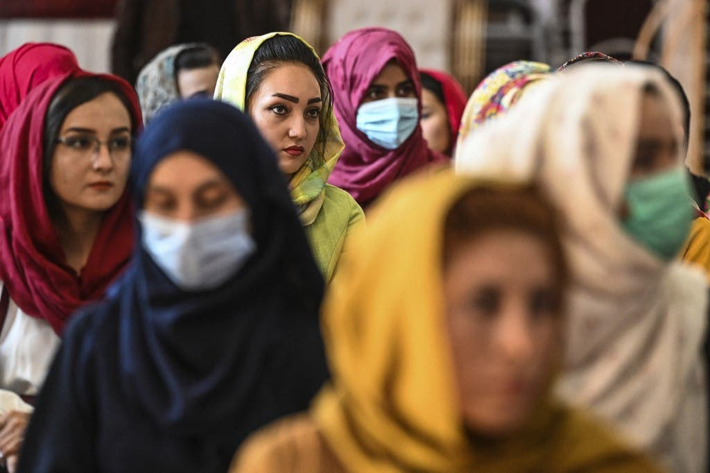 Afghan women take part in a gathering at a hall in Kabul on August 2, 2021 against the claimed human rights violations on women by the Taliban regime in Afghanistan. (AFP)