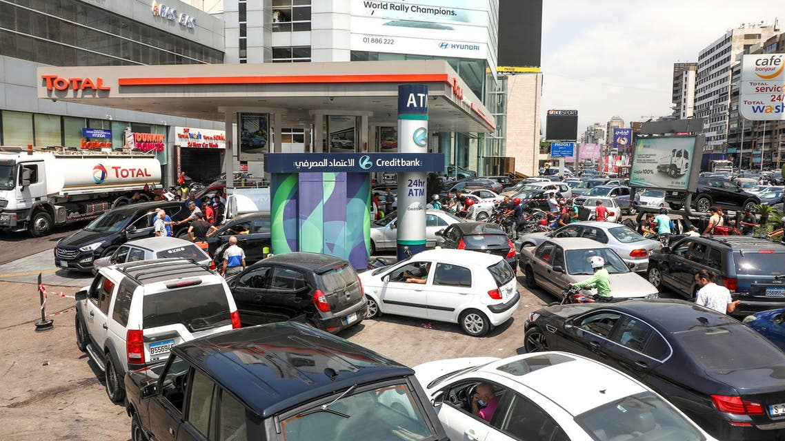 FILE PHOTO: People wait in cars to get fuel at a gas station in Zalka, Lebanon, August 20, 2021. REUTERS/Mohamed Azakir/File Photo