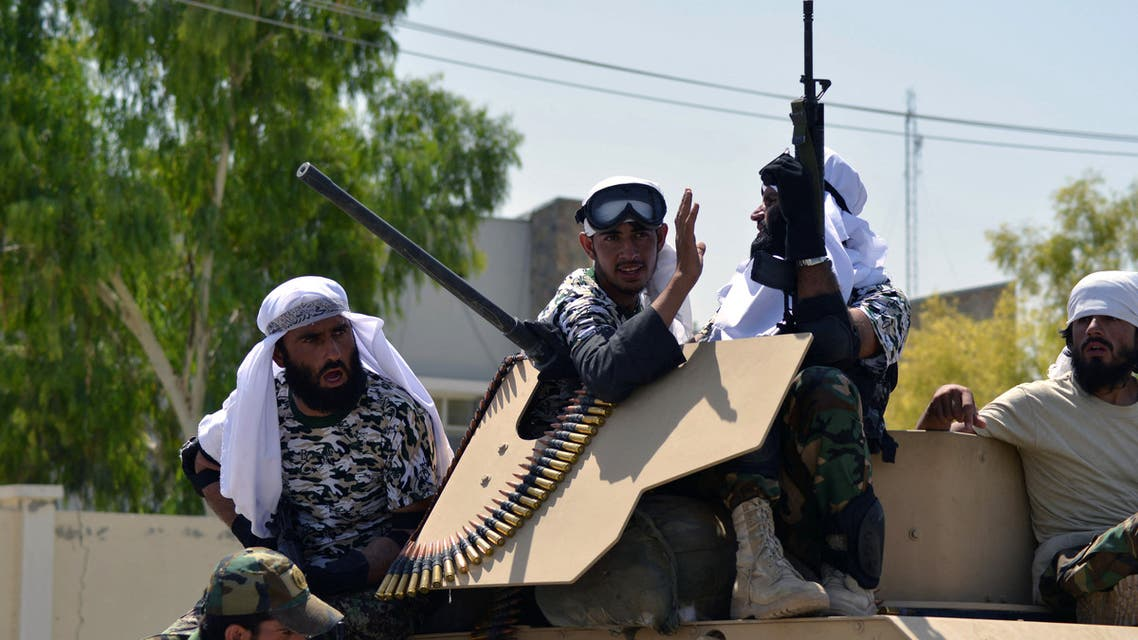 Taliban fighters stand on an armoured vehicle before parading along a road to celebrate after the US pulled all its troops out of Afghanistan, in Kandahar on September 1, 2021 following the Taliban's military takeover of the country. (AFP)