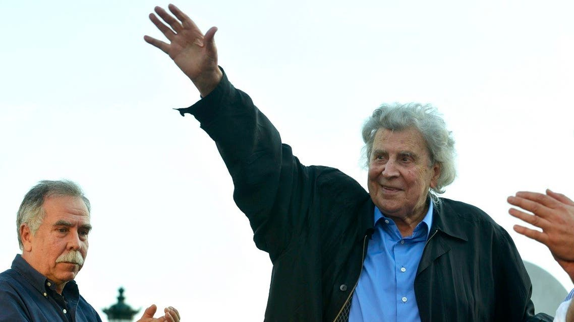 Greek composer Mikis Theodorakis waves to a gathered crowd during his speech in a massive peaceful rally against austerity measures on June 9, 2011, at the Aristotle Square in the northern port of Thessaloniki, Greece. (AP)