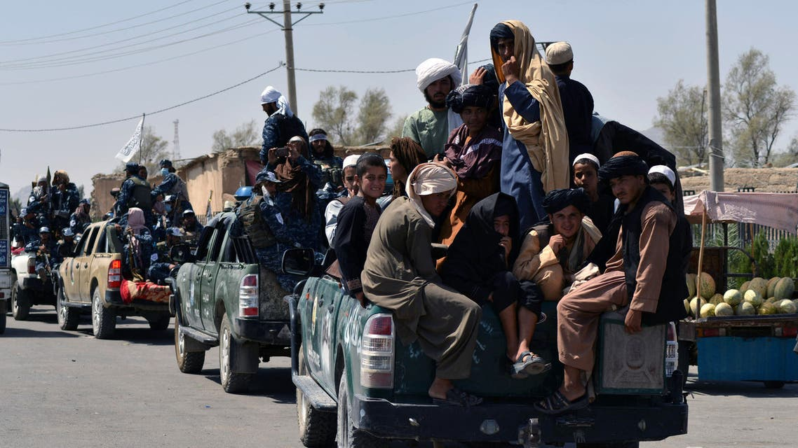 Taliban fighters atop Humvee vehicles prepare before parading along a road to celebrate after the US pulled all its troops out of Afghanistan, in Kandahar on September 1, 2021 following the Taliban's military takeover of the country.