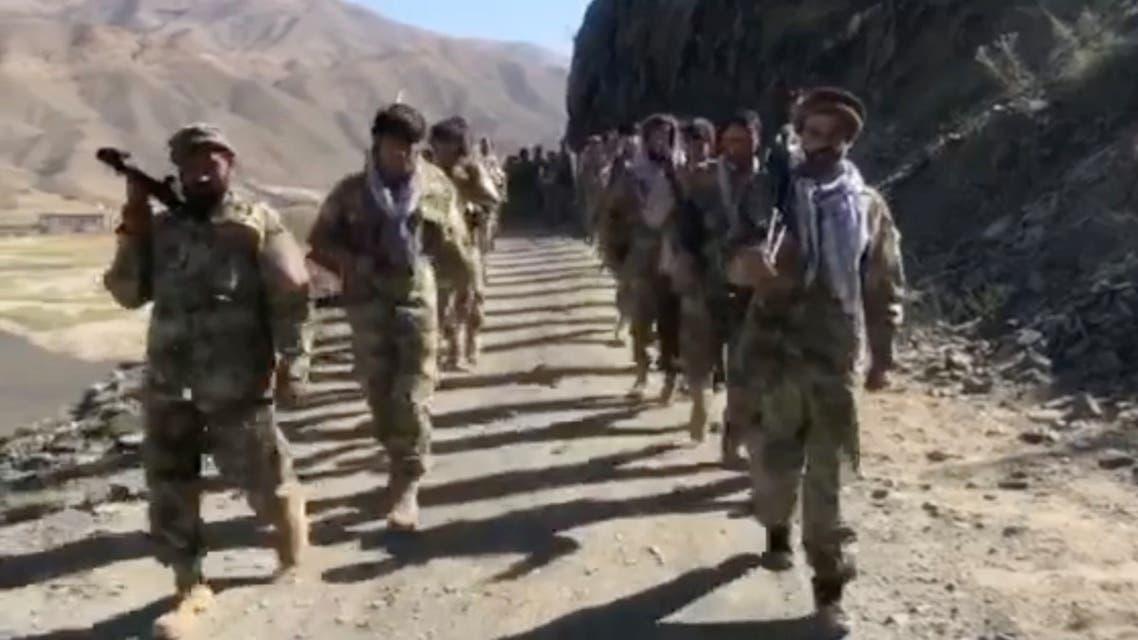 Anti-Taliban resistance troops walk in Panjshir Valley, Afghanistan, on August 25, 2021 in this still image taken from video. (Reuters)