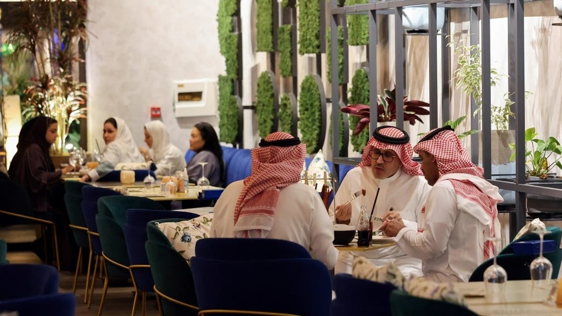 Saudi people eat dinner at David Burke's restaurant, in The Zone restaurant complex, in Riyadh, Saudi Arabia August 25, 2021. (Reuters)