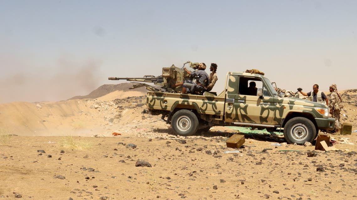 A Yemeni government fighter fires a vehicle-mounted weapon at a frontline position during fighting against Houthi fighters in Marib, Yemen March 28, 2021. Picture taken March 28, 2021. REUTERS/Ali Owidha
