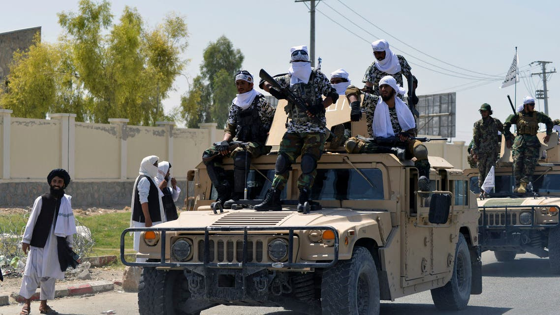 Taliban fighters stand on an armoured vehicle before parading along a road to celebrate after the US pulled all its troops out of Afghanistan, in Kandahar on September 1, 2021 following the Taliban's military takeover of the country.
