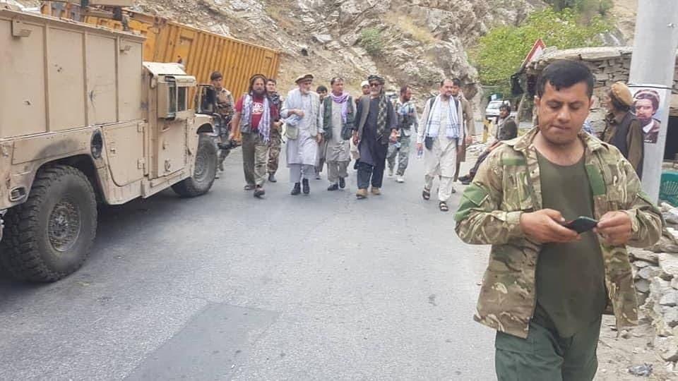 Anti-Taliban commanders walk on a road in Panjshir Valley, Afghanistan August 23, 2021.  (Reuters)