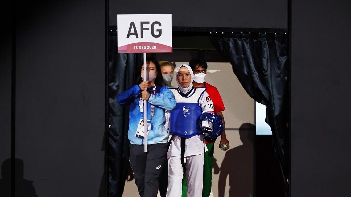 Taekwondo athlete Zakia Khudadadi of Afghanistan makes her entrance at the Tokyo 2020 Paralympic Games for her bout against Viktoriia Marchuk of Ukraine on September 2, 2021. (Reuters)