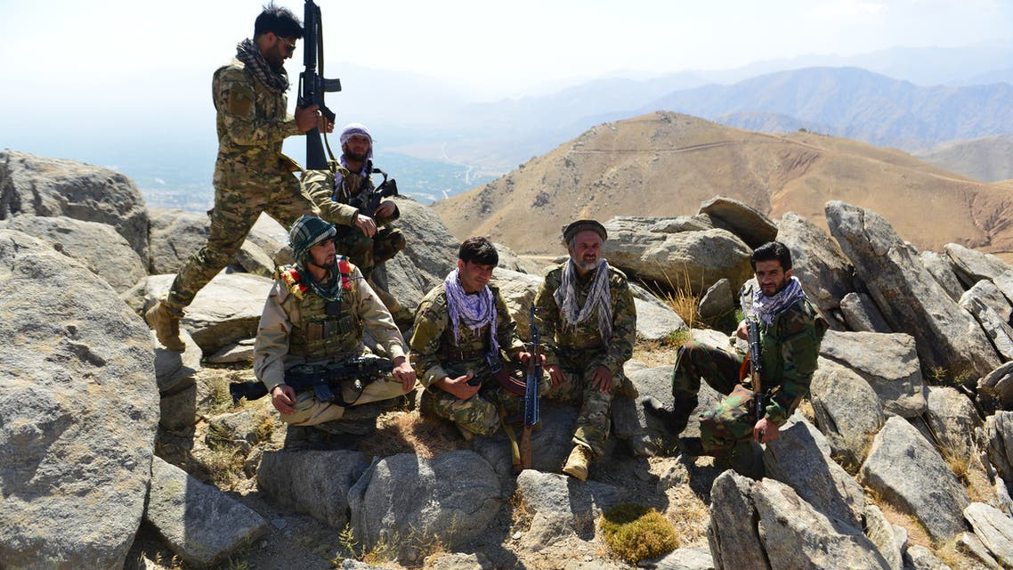 Afghan resistance movement and anti-Taliban uprising forces take rest as they patrol on a hilltop in Darband area in Anaba district, Panjshir province on September 1, 2021. Panjshir -- famous for its natural defences never penetrated by Soviet forces or the Taliban in earlier conflicts -- remains the last major holdout of anti-Taliban forces led by Ahmad Massoud, son of the famed Mujahideen leader Ahmed Shah Massoud.