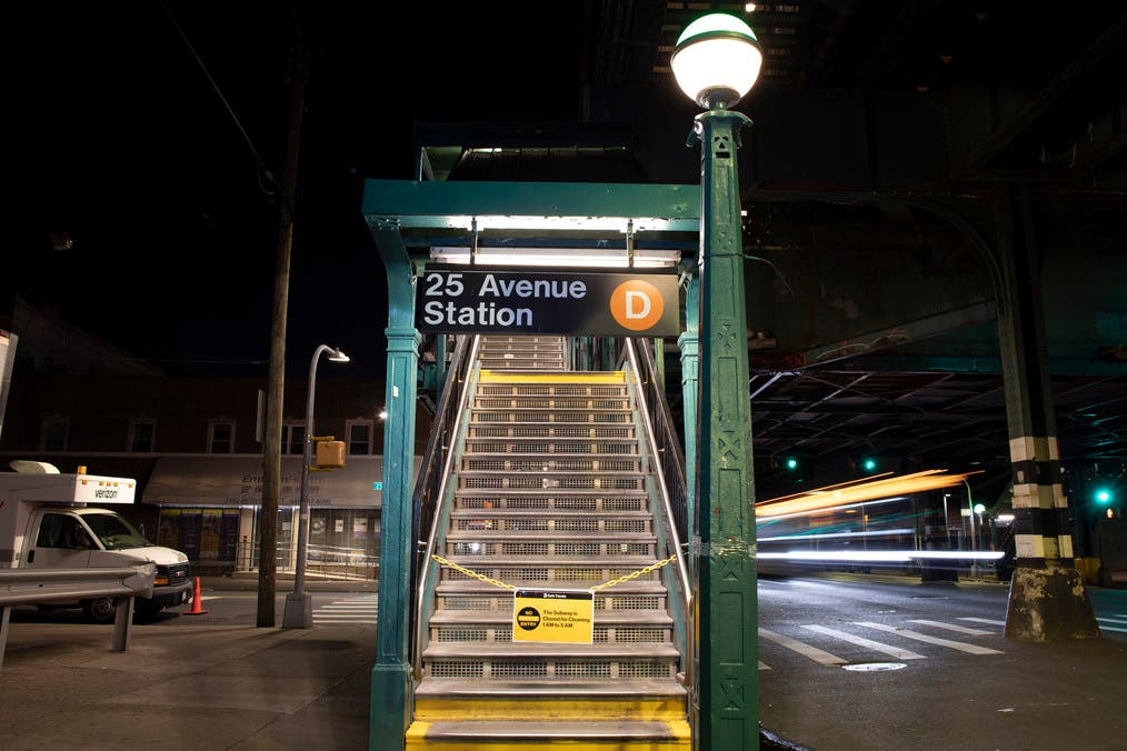 A sign on stairs to the 25th Avenue stop on the D subway line indicates that the subway system is closed overnight for cleaning during the coronavirus pandemic, Wednesday, May 13, 2020, in the Brooklyn borough of New York. (AP)