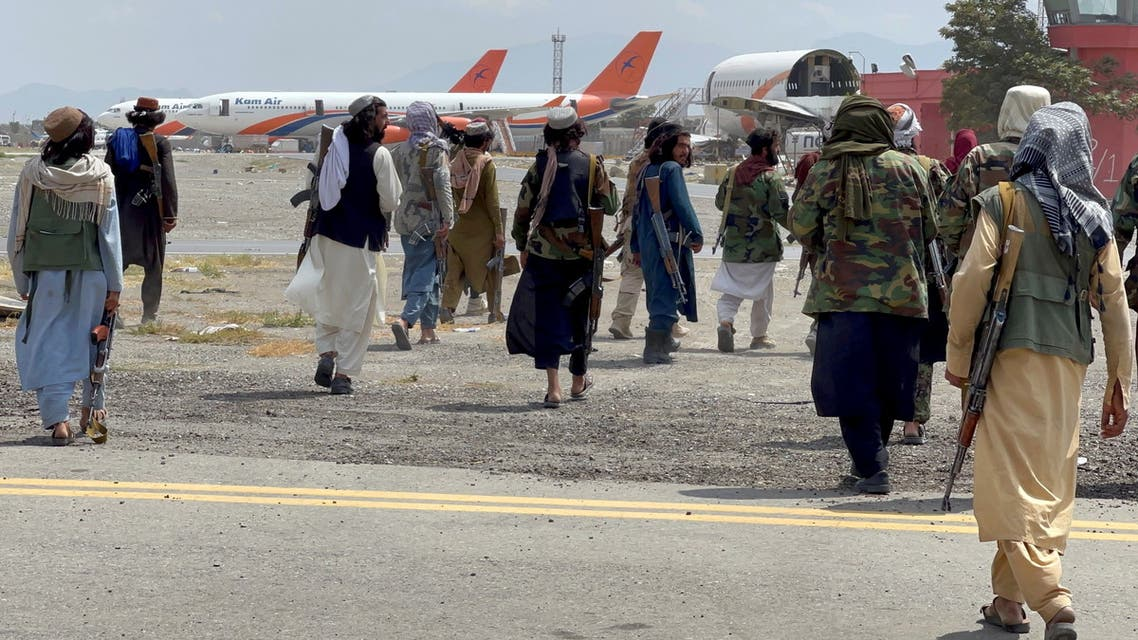 Taliban forces patrol at a runway a day after U.S troops withdrawal from Hamid Karzai International Airport in Kabul, Afghanistan August 31, 2021. (Reuters)