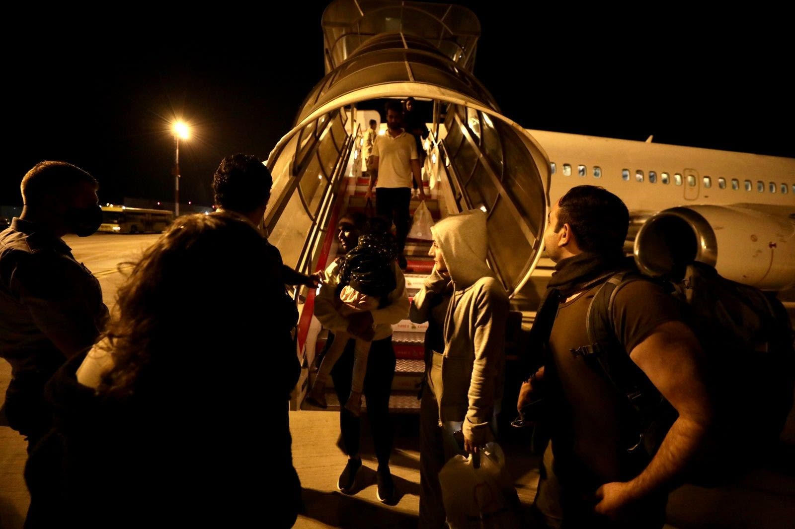 A plane carrying female Afghan activists evacuated from Kabul touches down in Albania. (Supplied)