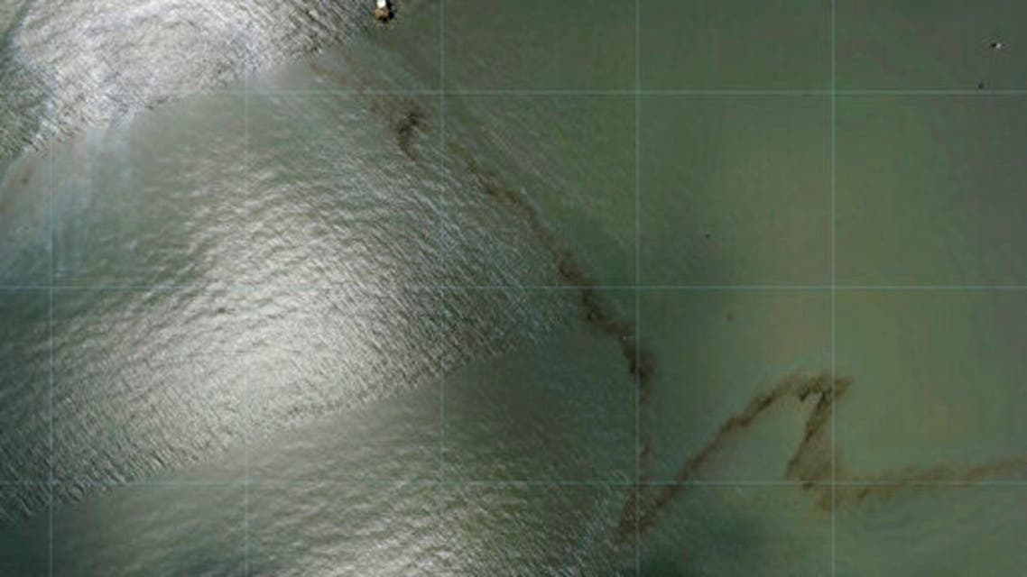 Photos captured by National Oceanic and Atmospheric Administration aircraft Tuesday, Aug. 31, 2021 and reviewed by The Associated Press show a miles long black slick floating in the Gulf of Mexico near a large rig marked with the name Enterprise Offshore Drilling. (AP)