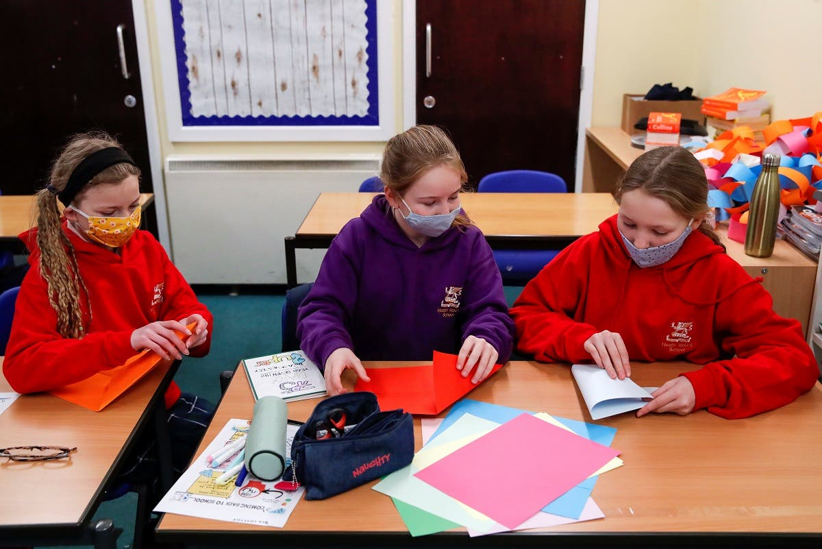 Students fold paper during a lesson at Heath Mount school as schools reopen in England, amid the coronavirus disease (COVID-19) pandemic, in Watton at Stone, Hertfordshire, Britain. (Reuters)