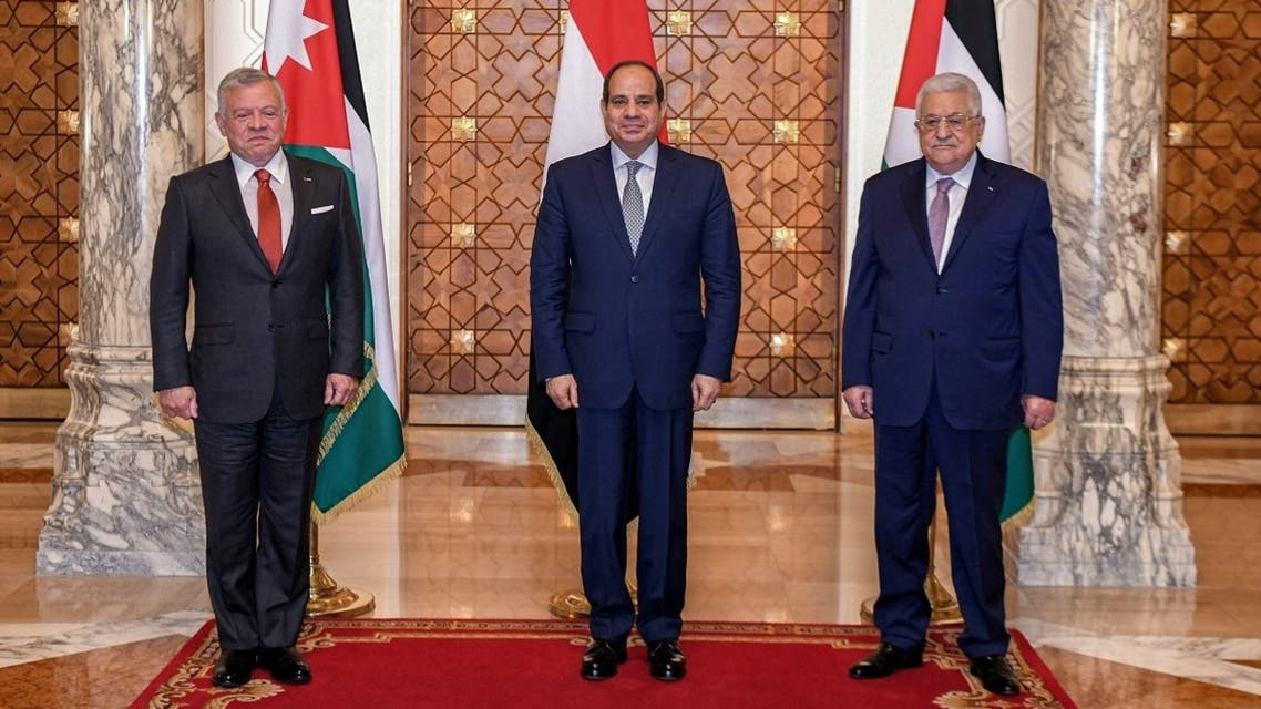 A handout picture released by the Egyptian Presidency on September 2, 2021 shows (L to R) Jordan's King Abdullah II, Egypt's President al-Sisi, and Palestinian President Abbas posing together for a group photo during a trilateral summit in Cairo. (Egyptian Presidency/AFP)