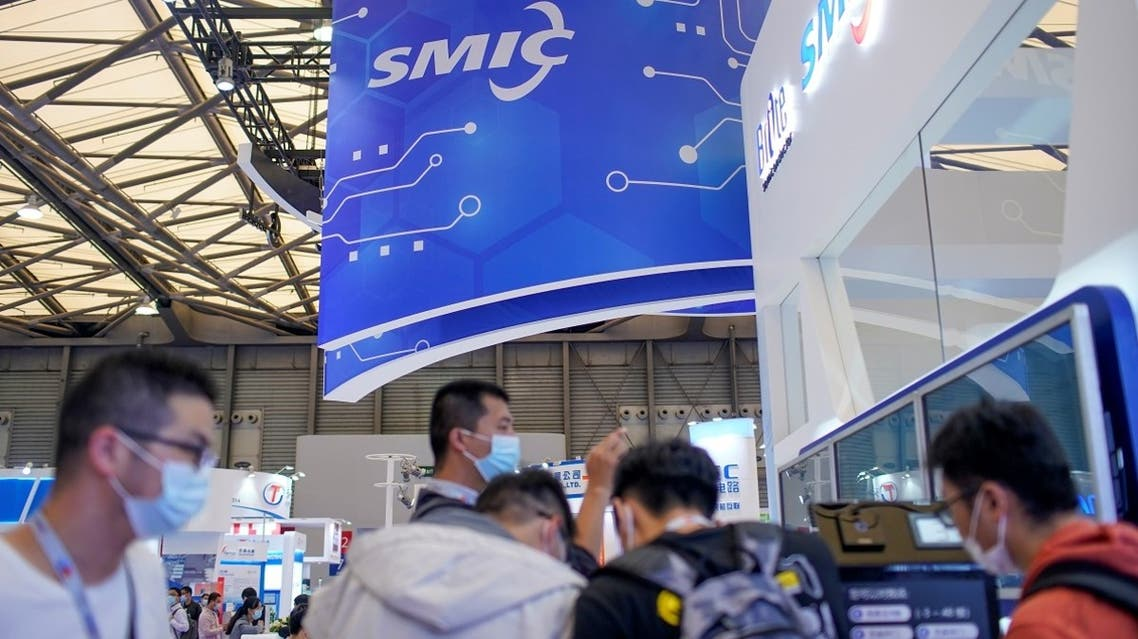 People visit a booth of Semiconductor Manufacturing International Corporation (SMIC), at China International Semiconductor Expo (IC China 2020) in Shanghai, China, on October 14, 2020. (Reuters)