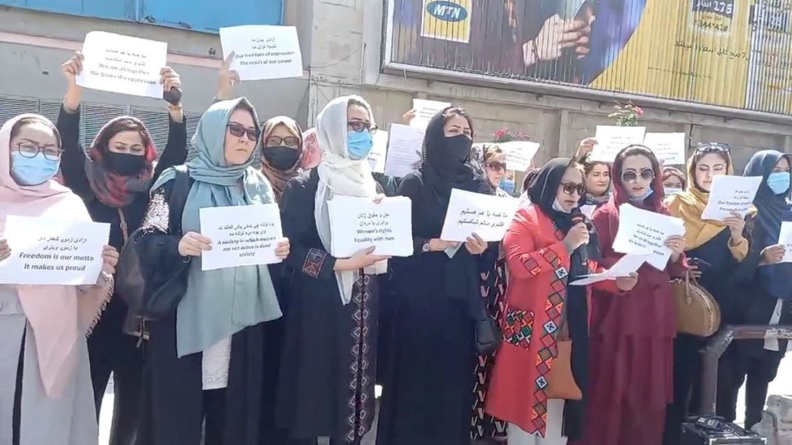 Women hold placards as they protest in Kabul, Afghanistan, on September 3, 2021 in this still image obtained from a social media video. (Reuters)