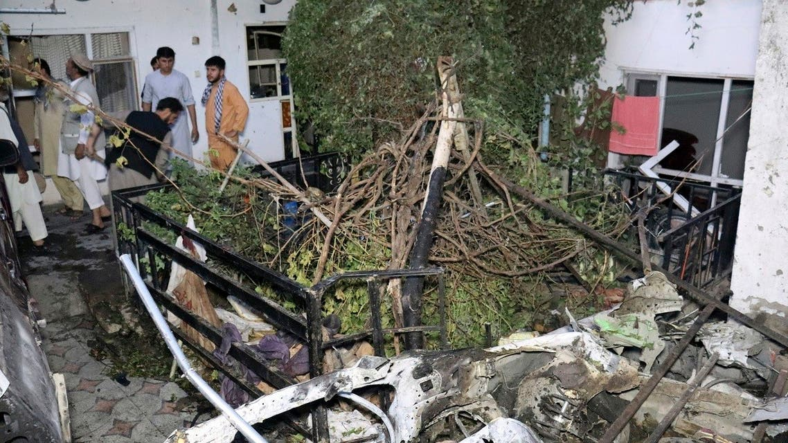Afghans inspect damage of Ahmadi family house after US drone strike in Kabul, Afghanistan, Aug. 29, 2021. (AP)