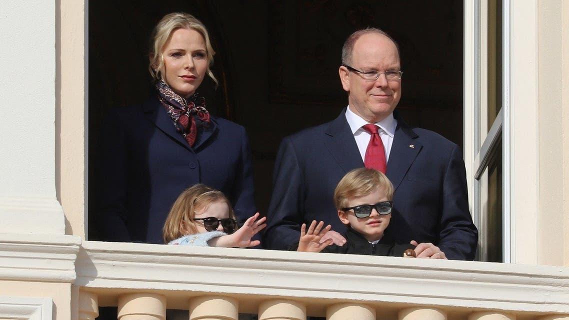 Prince Albert II of Monaco, Princess Charlene of Monaco, Prince Jacques and Princess Gabriella appear on the palace's balcony in Monaco on January 27, 2020. (Valery Hache/AFP)