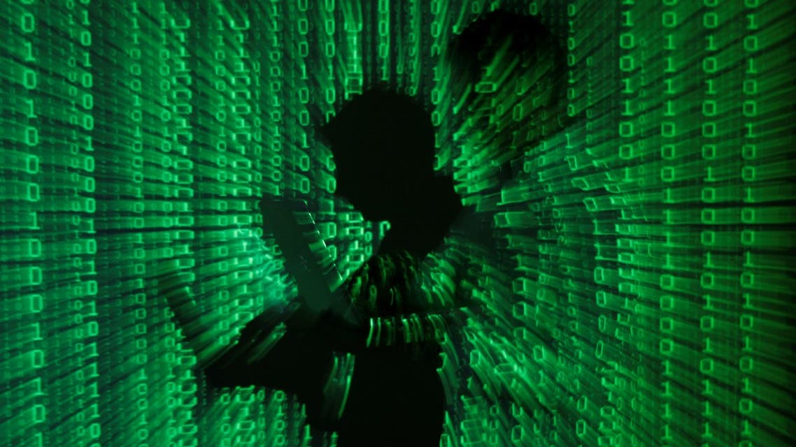 An illustration picture shows a projection of binary code on a man holding a laptop computer, in an office in Warsaw June 24, 2013. (File Photo: Reuters)