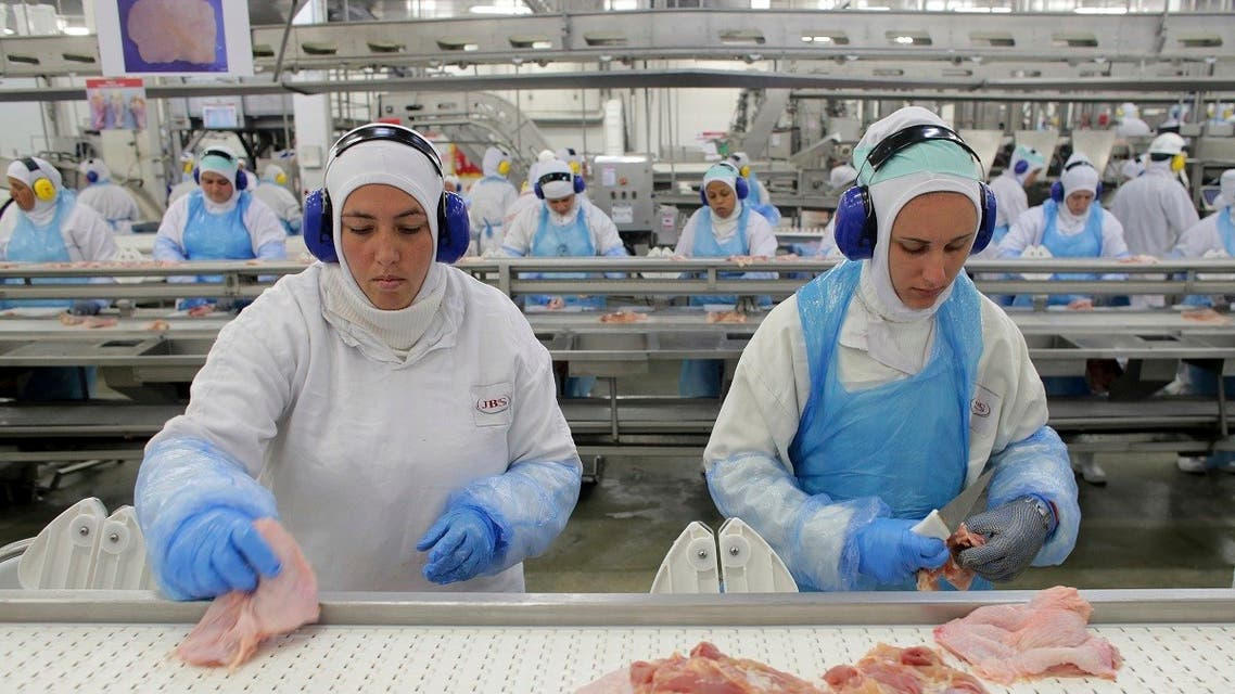 In this March 21, 2017 file photo, workers prep poultry at the meatpacking company JBS in Lapa, Brazil. (AP)