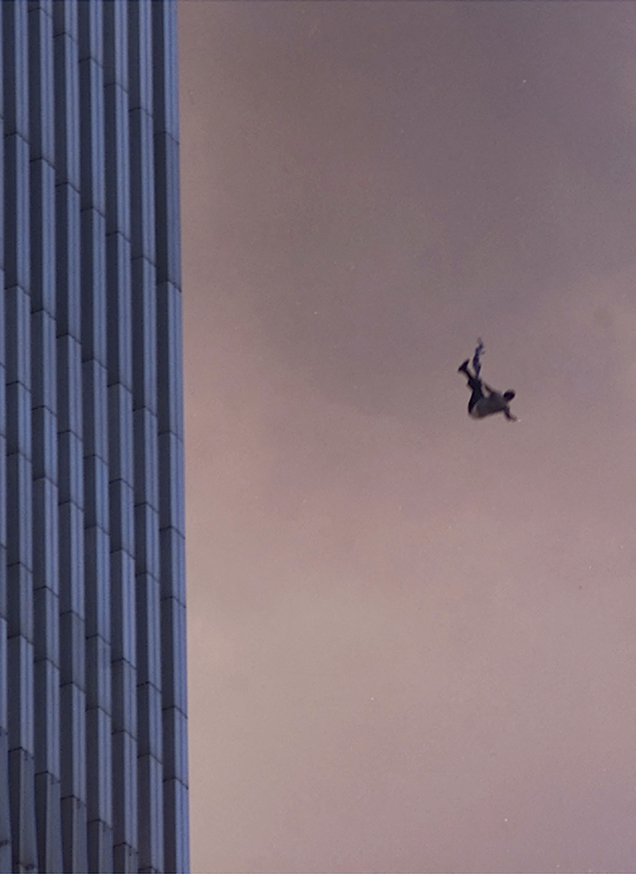 A person falls to his death from the World Trade Center after two planes hit the Twin Towers September 11, 2001 in New York City. (AFP)