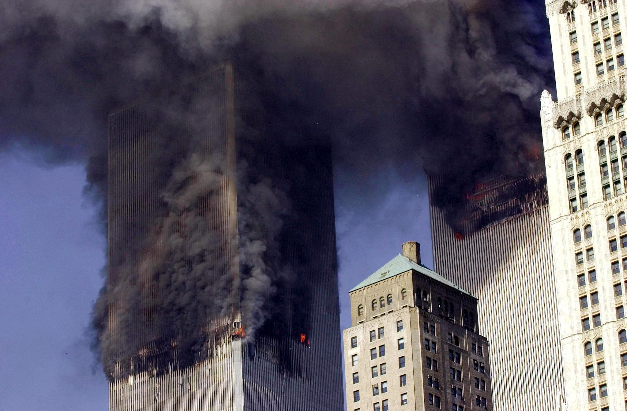 Photo dated 11 September 2001 shows the twin towers of the World Trade Center burning after two planes crashed into each building in New York. (AFP)