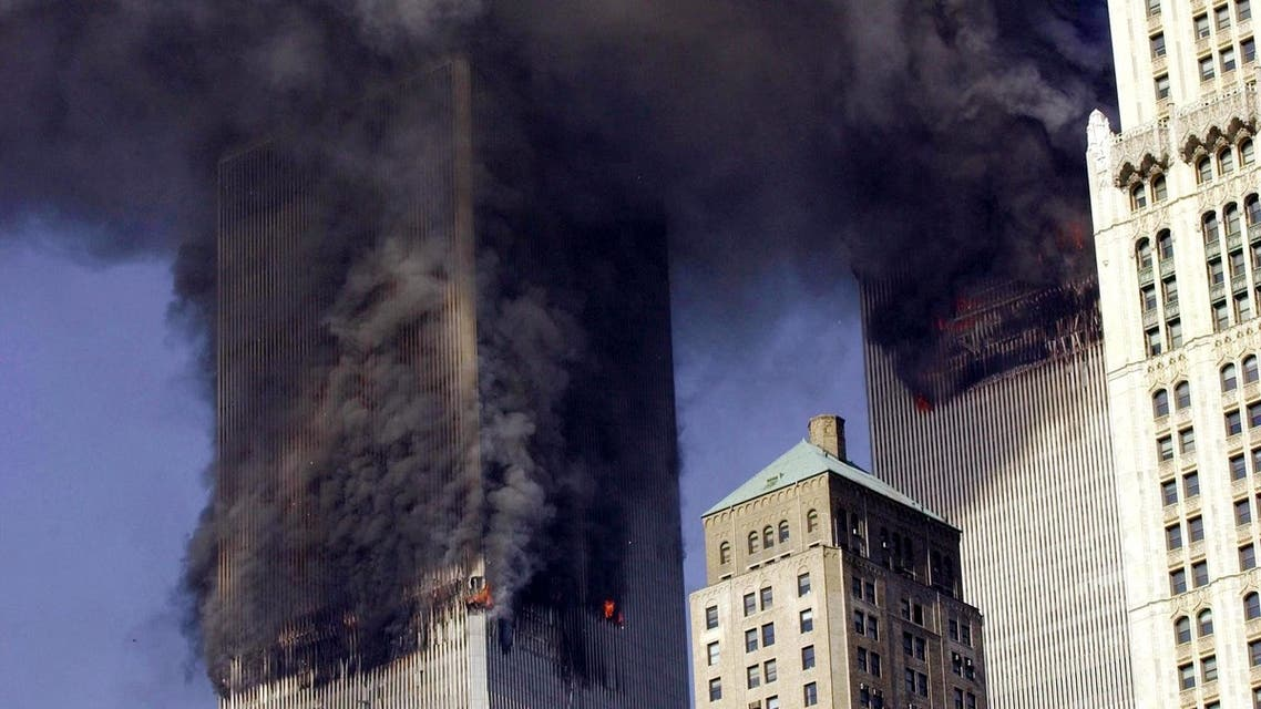 (FILES) Photo dated 11 September 2001 shows the twin towers of the World Trade Center burning after two planes crashed into each building in New York. The fifth anniversary of September 11 finds the United States bloodied by foreign war, polarized politically and coping with terrorism's curbs on freedom which helped define American life. AFP PHOTO/FILES/Stan HONDA **MORE PICTURES AVAILABLE ON WWW.IMAGEFORUM2.AFP.COM**  STAN HONDA / AFP