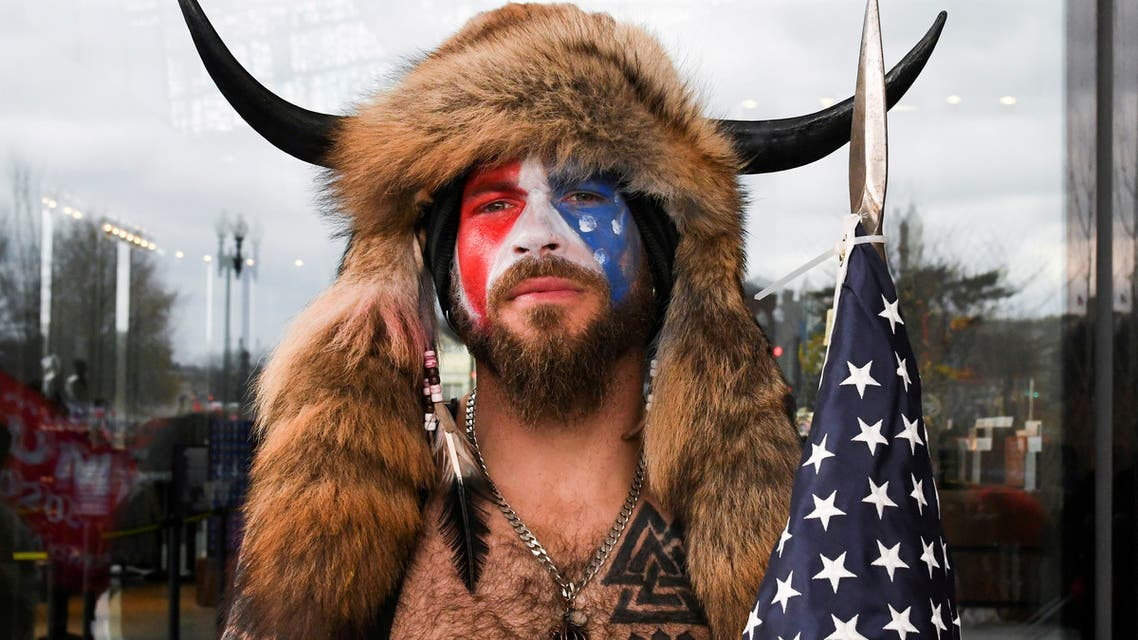 Jacob Anthony Chansley, also known as Jake Angeli, of Arizona, poses with his face painted in the colors of the U.S. flag as supporters of U.S. President Donald Trump gather in Washington, U.S. January 6, 2021. (File Photo: Reuters)