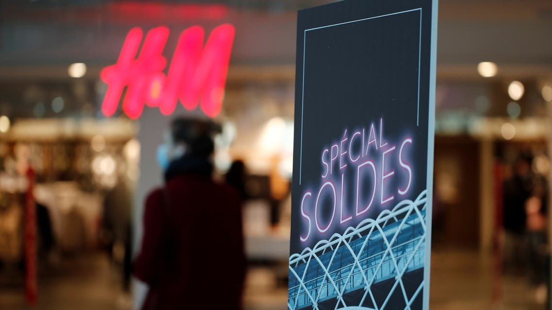 A discount sale sign is seen on a storefront window on the first day of winter sales at the Beaugrenelle shopping mall in Paris, France, January 20, 2021. REUTERS/Benoit Tessier