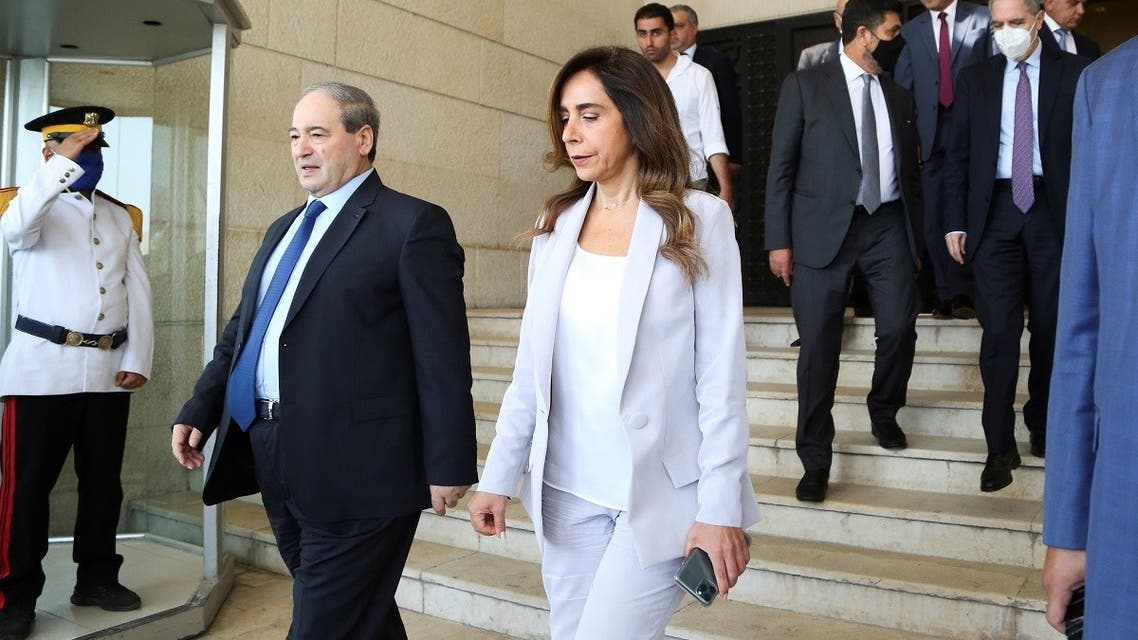 Syrian Foreign Minister Faisal al Mekdad, walks with Lebanon's caretaker Foreign Minister and Defense Zeina Akkar after their meeting in Damascus, Syria September 4, 2021.  (Reuters)
