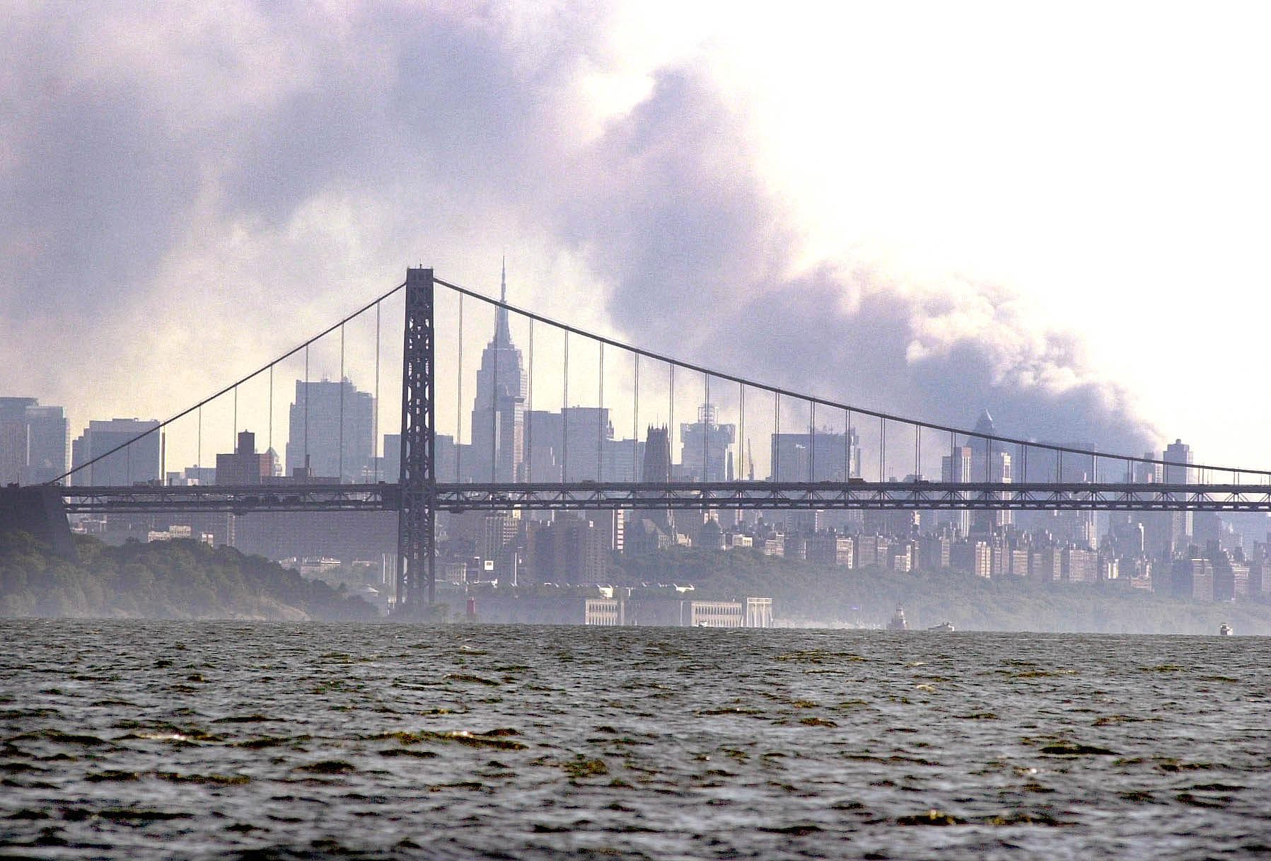 Smoke rises from the New York skyline 11 September 2001 after two hijacked planes crashed into the landmark World Trade Center. (AFP)