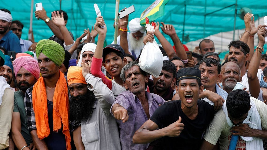 People shout slogans during a Maha Panchayat or grand village council meeting as part of a farmers' protest against farm laws in Muzaffarnagar in the northern state of Uttar Pradesh, India, September 5, 2021. (Reuters)