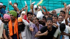 Thousands of Indian farmers rally against new agricultural laws