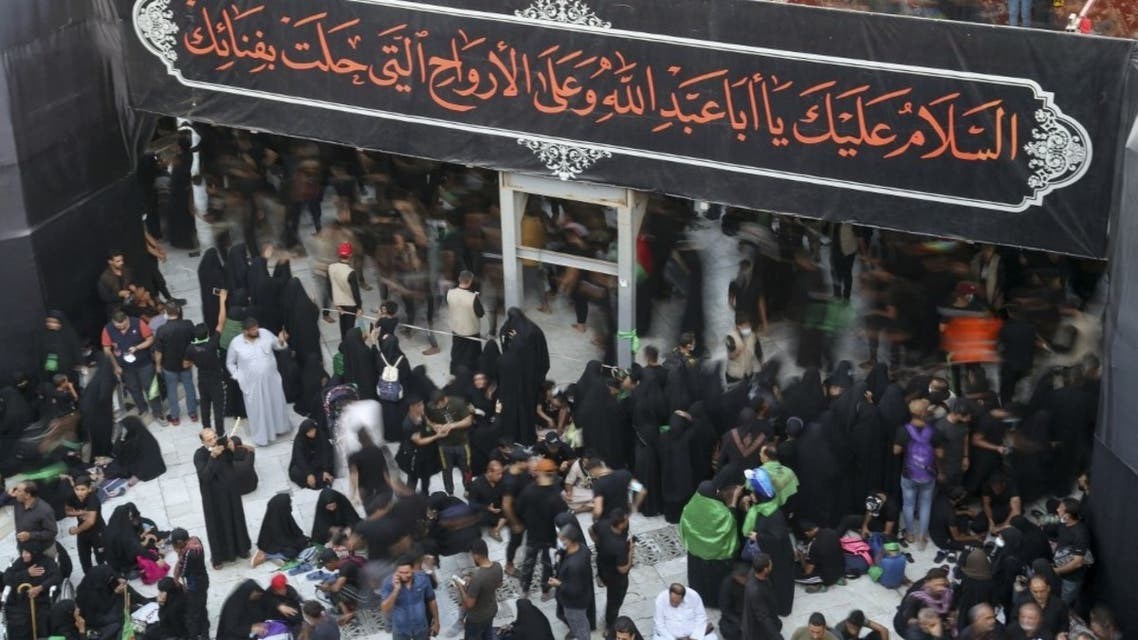 Shia Muslims gather in mourning a day ahead of Arbaeen, which marks the end of the 40-day mourning period for the seventh century killing of Imam Hussein, Prophet Mohammed's grandson, in Iraq's central holy city of Karbala, on October 7, 2020. (AFP)