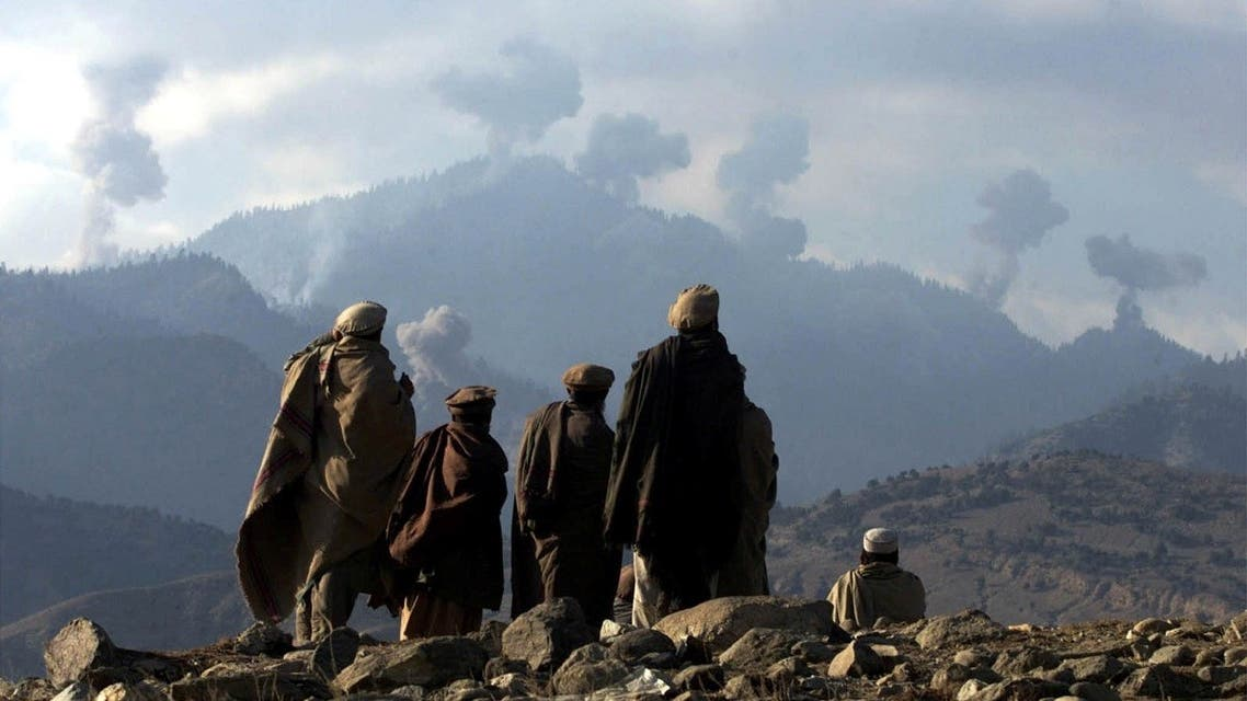 Anti-Taliban Afghan fighters watch several explosions from U.S. bombings in the Tora Bora mountains in Afghanistan in the hunt for al-Qaeda fighters. (File photo: Reuters)