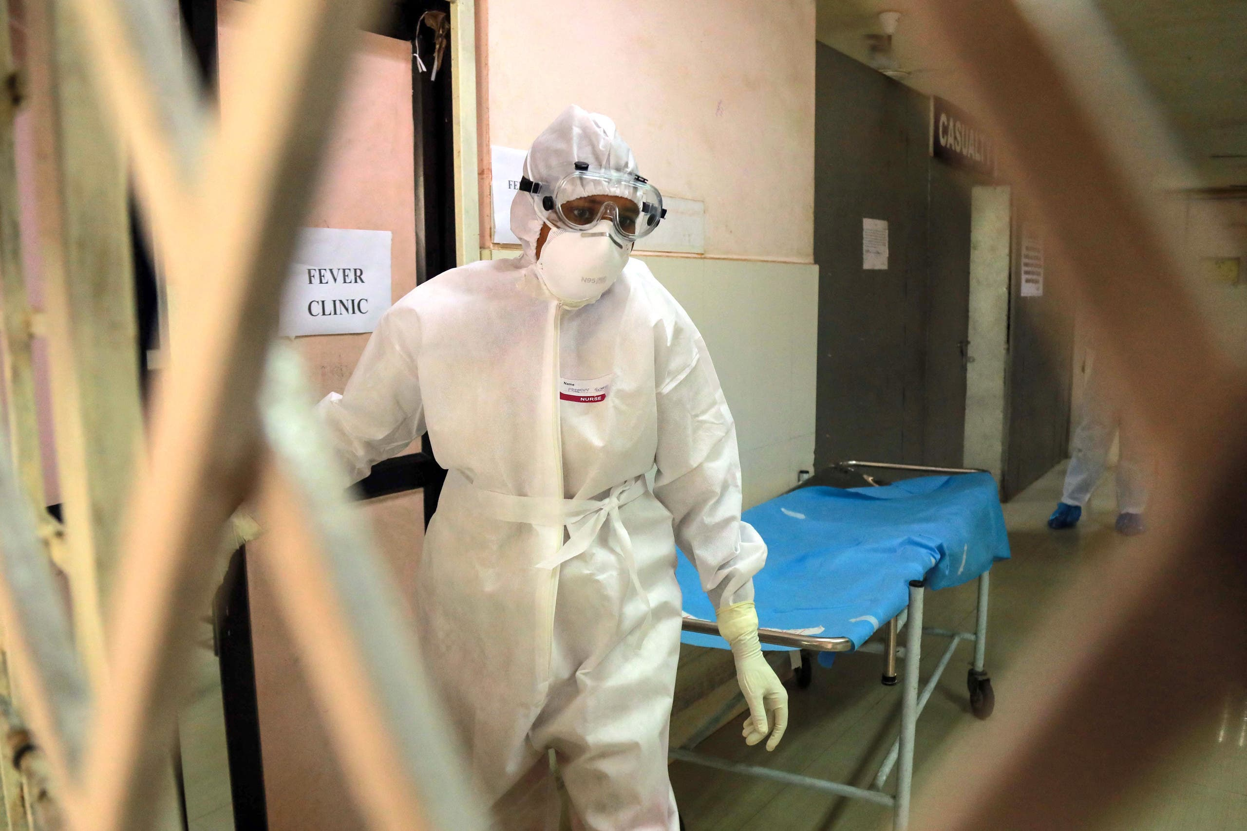 Health officials in full protective gear walk inside an isolation ward of Ernakulam Medical College in Kochi in the Indian southwestern state of Kerala on June 6, 2019. (File photo: AFP)