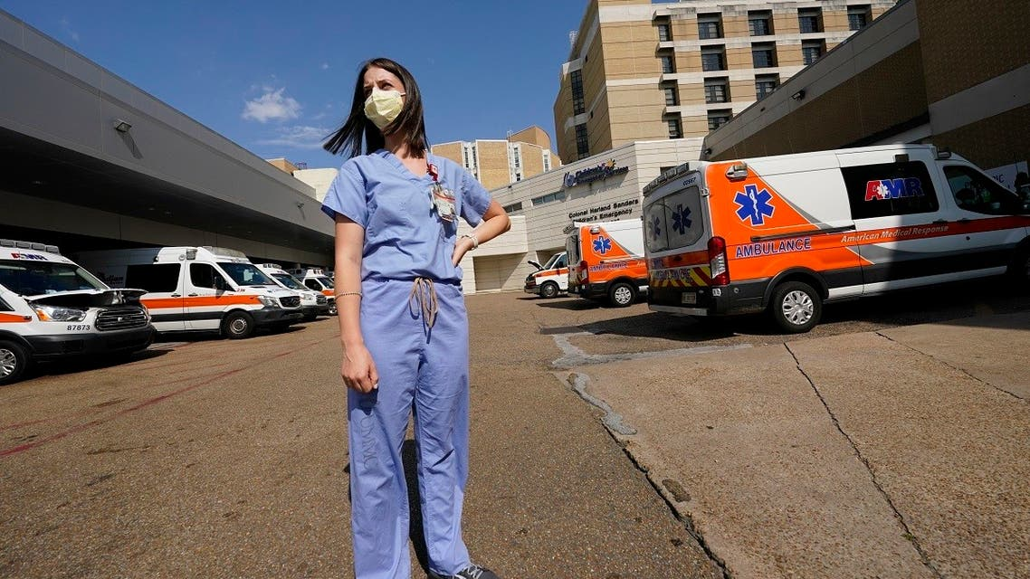 Anne Sinclair, a pediatric emergency room nurse at the University of Mississippi Medical Center, in Jackson, stands in the middle of the filled ambulance bay and wonders why some incoming patients and their parents have to be reminded to wear masks when they come to the hospital. (AP)