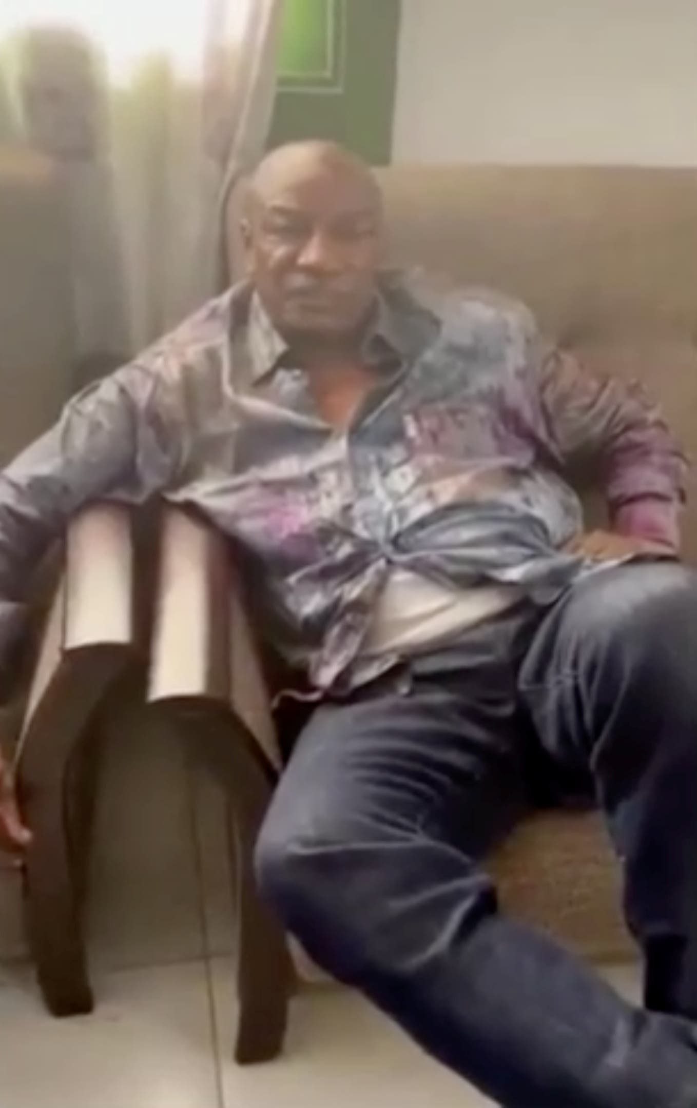 A screen grab from a video shared on social media, but not yet authenticated, claimed to show Guinea's President Alpha Conde detained by army special forces, in Conakry, Guinea September 5, 2021. (Video obtained by Reuters on September 5, 2021.)