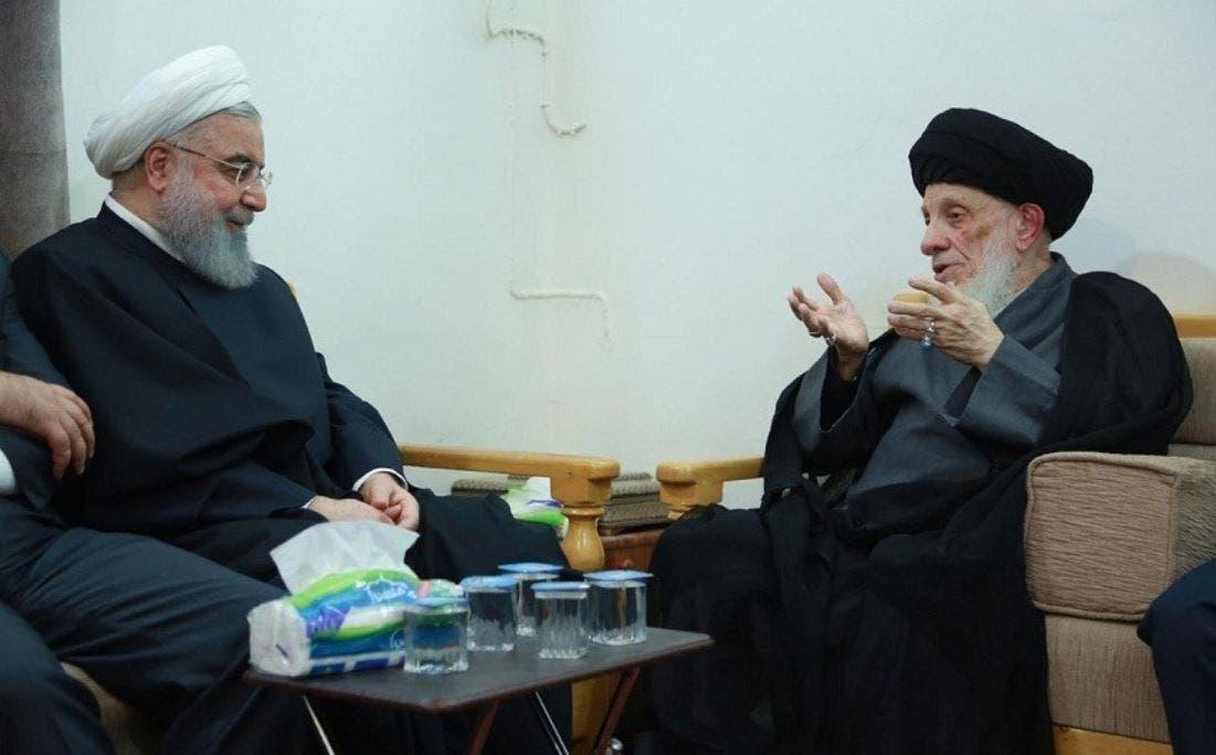 الرئيس الإيراني السابق حسن روحاني أثناء زيارته المرجع الراحل محمد سعيد الحكيم