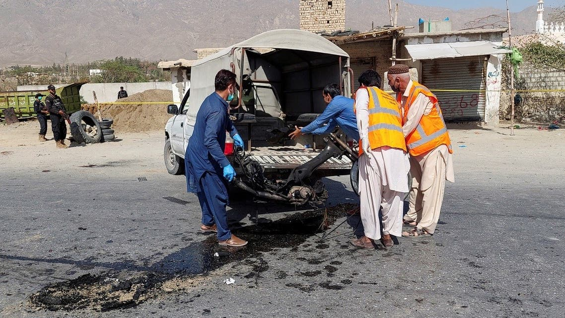 Members of the crime investigation team remove the wreckage from the site after a suicide blast on paramilitary force checkpoint in Quetta, Pakistan September 5, 2021. (Reuters)