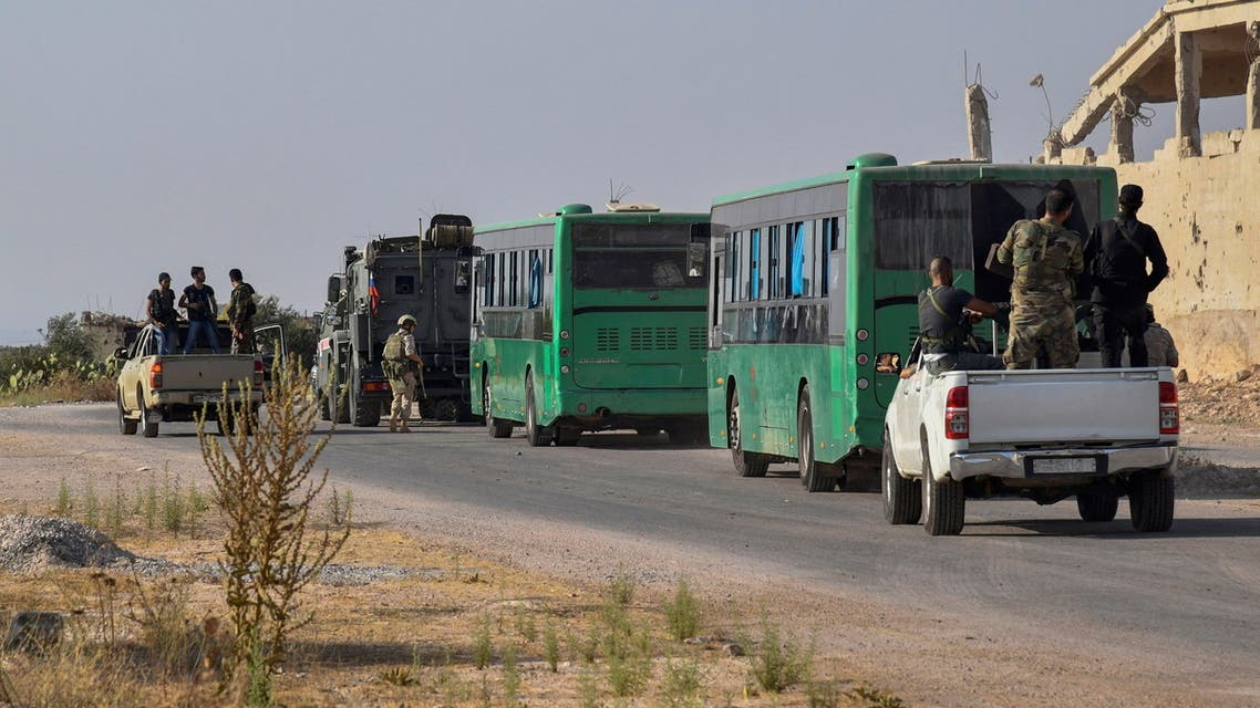 Buses carrying rebels and their families are seen in Deraa, Syria, in this handout released by SANA on August 26, 2021. SANA/Handout via REUTERS ATTENTION EDITORS - THIS IMAGE WAS PROVIDED BY A THIRD PARTY. REUTERS IS UNABLE TO INDEPENDENTLY VERIFY THIS IMAGE.