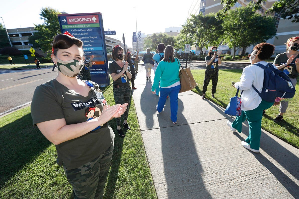 University of Mississippi Medical Center team leader nurse Kim Barrier applauds incoming medical shifts at the University of Mississippi Medical Center in Jackson, Wednesday, May 6, 2020. (AP)