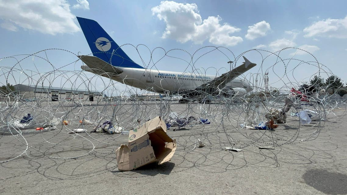 FILE PHOTO: A commercial airplane is seen at the Hamid Karzai International Airport a day after U.S troops withdrawal in Kabul, Afghanistan August 31, 2021. REUTERS/Stringer/File Photo