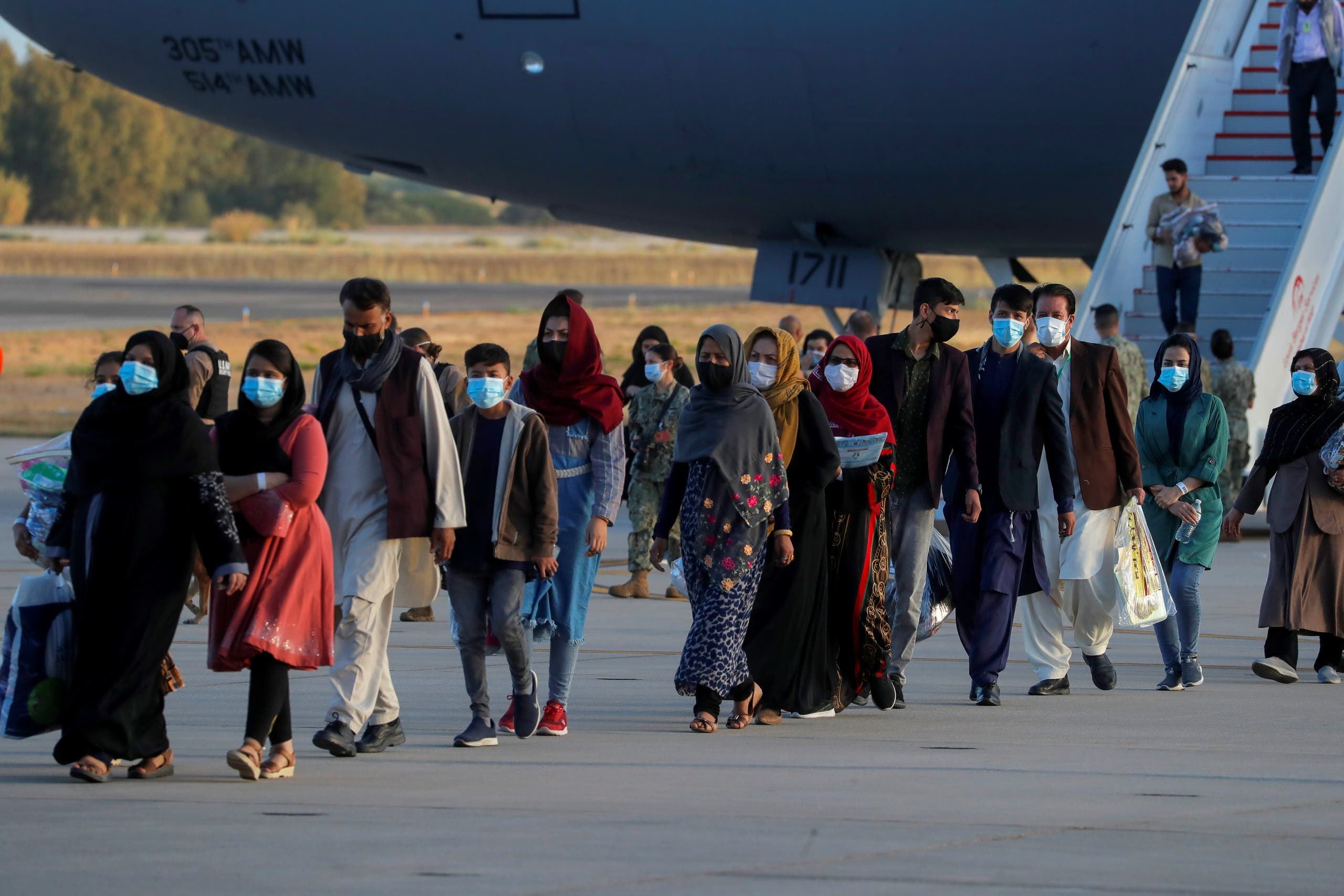 Afghan citizens, who have been evacuated from Kabul, disembark from a U.S Air Force transport plane as they arrive at Naval Station (NAVSTA) Rota Air Base in Rota, southern Spain, August 31, 2021. (File photo: Reuters)