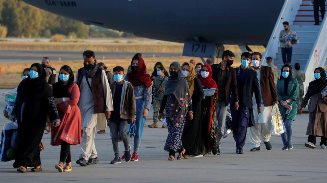 Afghan citizens, who have been evacuated from Kabul, disembark from a U.S Air Force transport plane as they arrive at Naval Station (NAVSTA) Rota Air Base in Rota, southern Spain, August 31, 2021. REUTERS/Jon Nazca