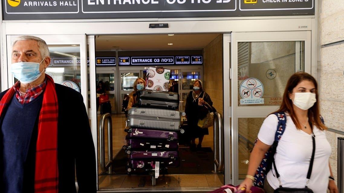 Travellers exit Israel's Ben Gurion International Airport, amid a spread of the Delta variant of the coronavirus disease (COVID-19), near Tel Aviv, Israel July 8, 2021. (Reuters)