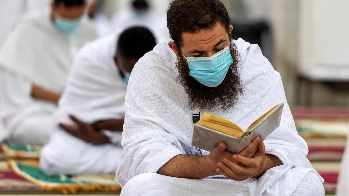 A Muslim pilgrim wearing a protective mask, reads the Quran inside Namira Mosque in Arafat to mark Haj's most important day, Day of Arafat, during his Hajj pilgrimage amid the coronavirus disease (COVID-19) pandemic, outside the holy city of Mecca. (Reuters)