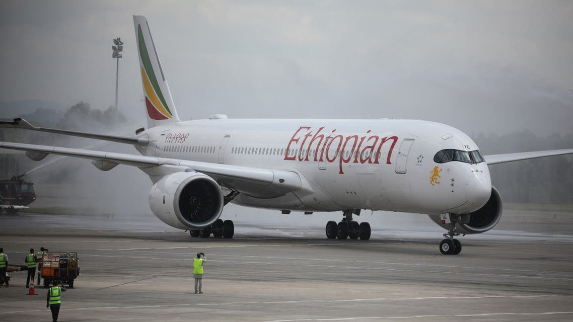 Disinfectant workers spray disinfectant on an Ethiopian Airlines plane arriving at the Nnamdi Azikiwe International Airport, in Abuja, Nigeria on September 7, 2020. After a five-month closure of the Nigerian airspace due to the COVID-19 coronavirus pandemic, flight resumptions began in Abuja, Nigeria.